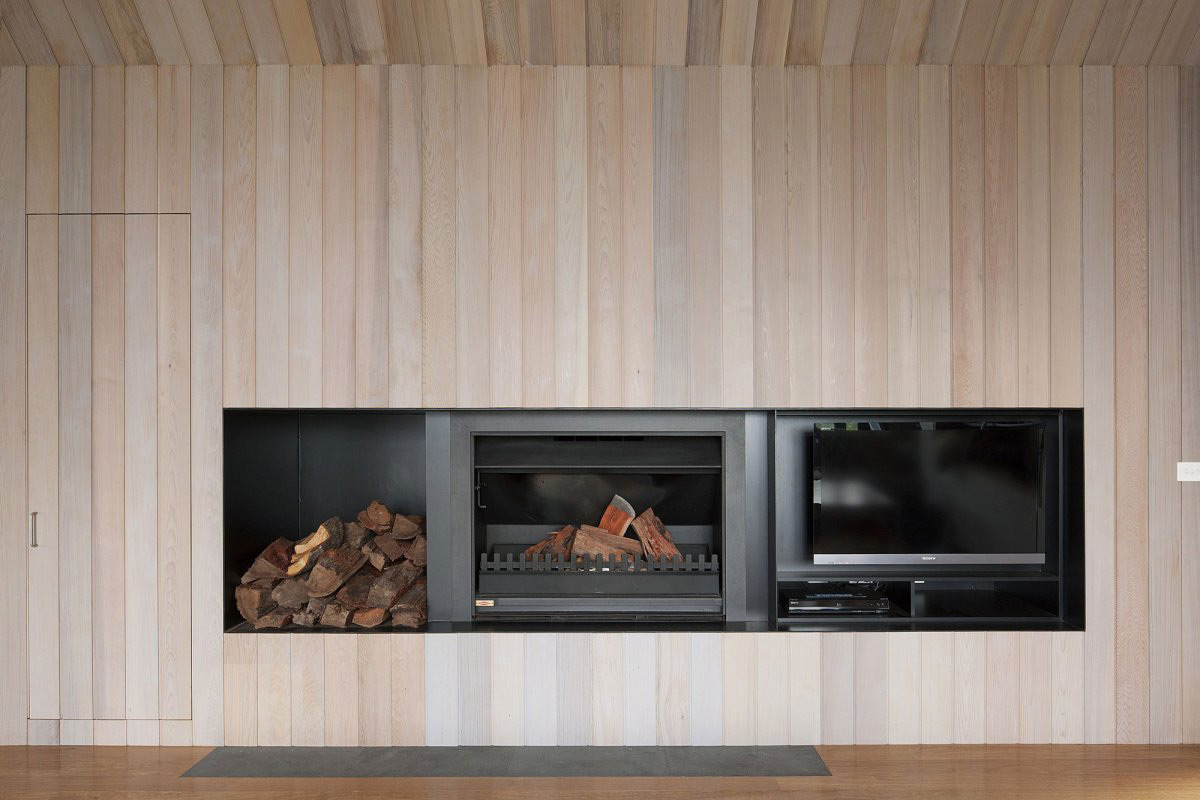 Modern Fireplace, Seaview House in Barwon Heads, Australia by Jackson Clements Burrows