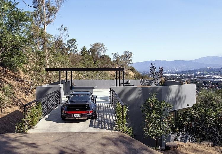 Bridge, Carport, Hillside House with a Rooftop Carport