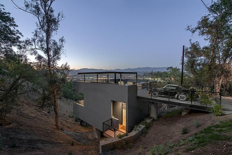 Side Facade, Carport, Hillside House with a Rooftop Carport