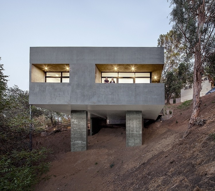 Exposed Concrete, Balcony, Hillside House with a Rooftop Carport