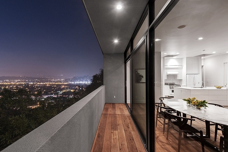 Wood & Concrete Balcony, Patio Doors, Hillside House with a Rooftop Carport