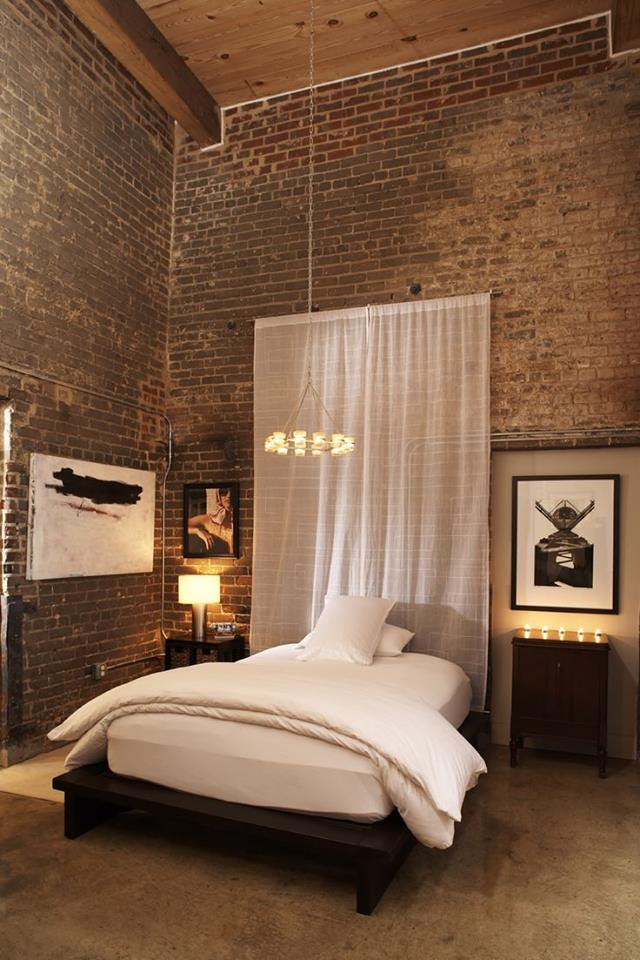 Bedroom with Double-Height Brick Walls