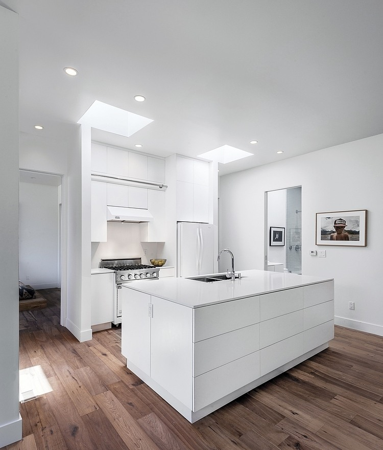 Bright White Kitchen, Wooden Flooring, Hillside House with a Rooftop Carport